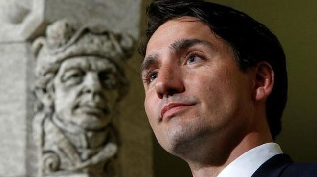 Canada's Trudeau welcomes refugees; U.S.-bound passengers turned away