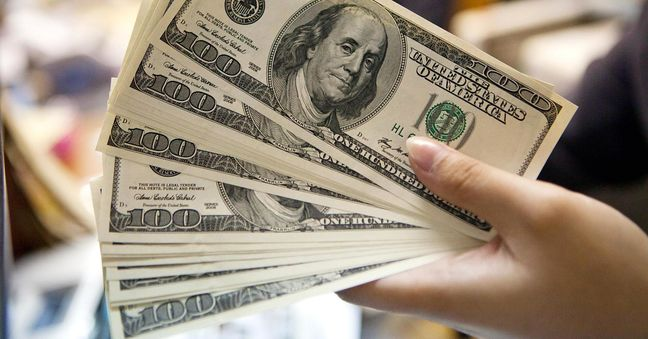 Dollar steps back from seven-month high; Aussie trims gains