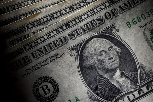 Dollar edges up, as investors wait on Fed, Jackson Hole