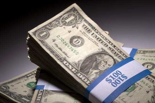 Stocks Fall, Dollar Sinks as Politics Take a Toll