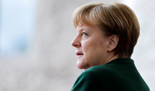 Merkel Says NATO Must Show Strength and Keep Dialog With Russia