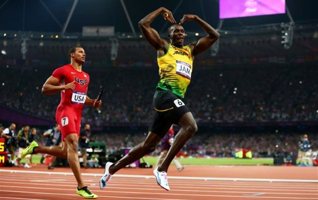 Unbeatable Bolt signs off with triple-triple