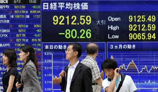 Asian shares mostly lower, oil near one-year high on output cut plan