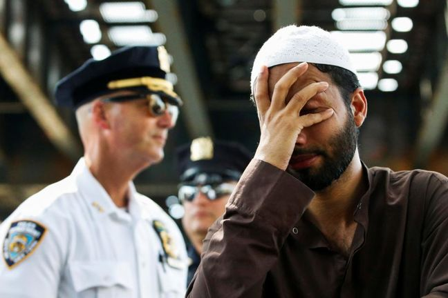New York man charged in slaying of Muslim imam, assistant
