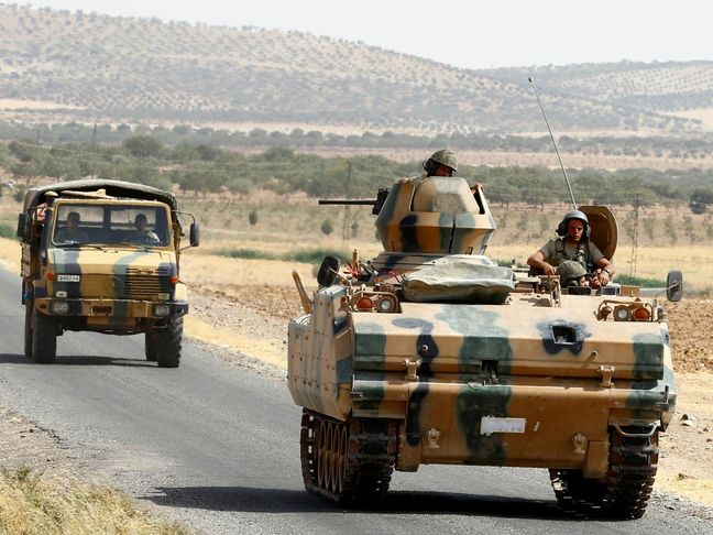 Turkish army thrusts deeper into Syria, monitor says 35 villagers killed
