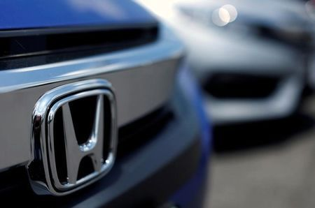Japan's Honda ties up with ride-hailing service Grab