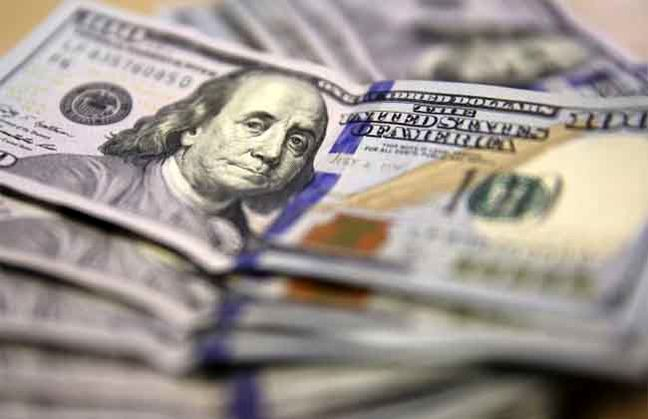 Dollar claws back some losses as investors look to U.S. data, OPEC