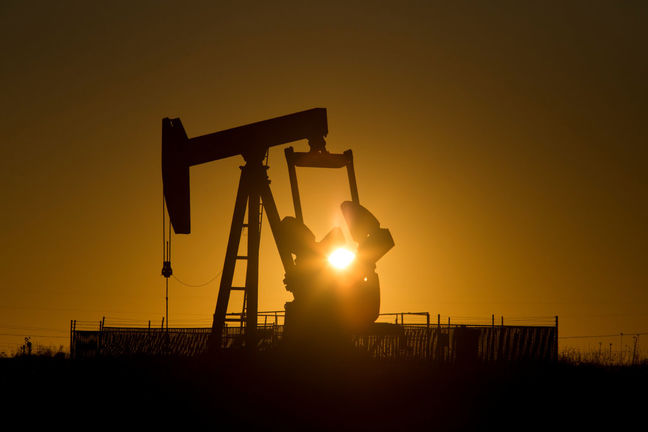 Oil prices fall on surging Iran sales, but looming OPEC deal offers support
