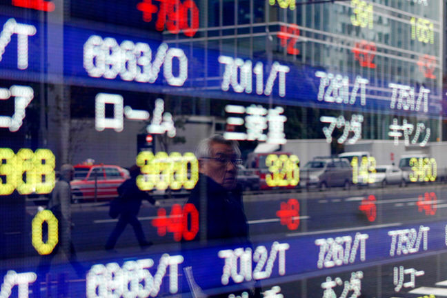 Strong dollar hits Asian share markets, oil surges
