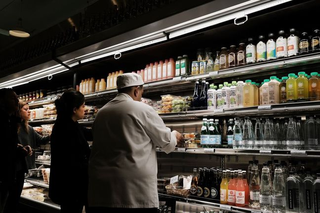U.S. inflation tame despite economy gaining momentum