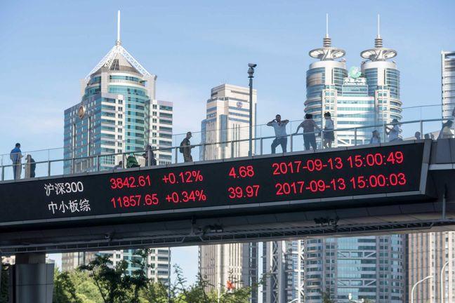 Stocks in Asia Mixed Ahead of Fed as Yuan Retreats
