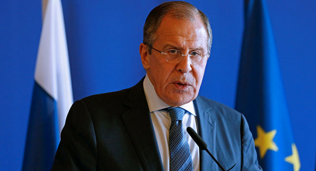 Russian foreign minister meets with Tillerson, denies interfering