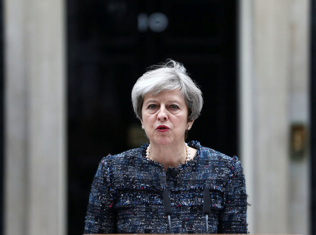 UK PM Theresa May maintains strong election lead in weekend opinion polls