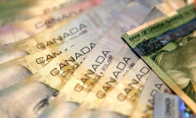 U.S. Stocks Near Records, Canadian Dollar Weakens