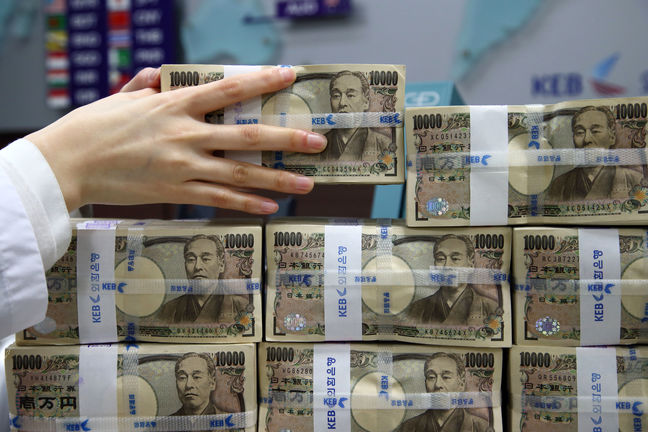 Japan's top FX diplomat signals readiness to intervene as yen spikes